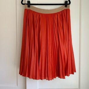 Pleated midi skirt- coral/flame color